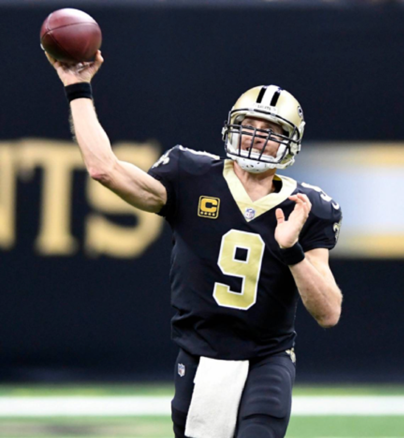 Drew Brees throwing a football
